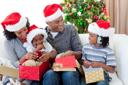 Happy Afro-American family opening Christmas presents Stock Photo - 10222164