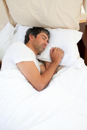 Doleful man sleeping photo