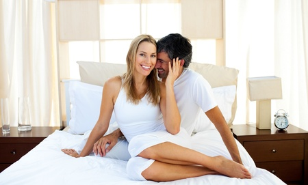 lovers in bed: Caring lovers embracing on bed  Stock Photo