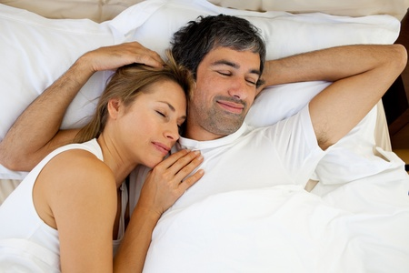 Positive couple sleeping photo