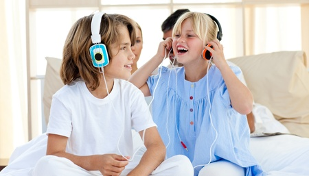 Joyful children having fun and listening music photo