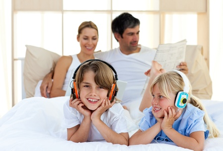 Brother and sister listening music with headphones Stock Photo - 10257245