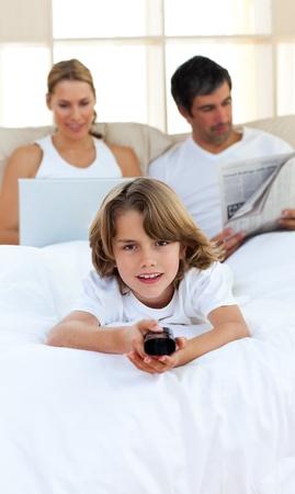 Joyful child holding a remote  photo