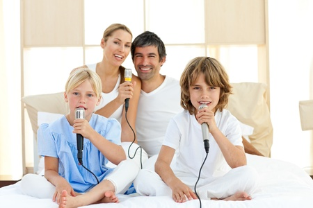Jolly family singing together Stock Photo - 10259022