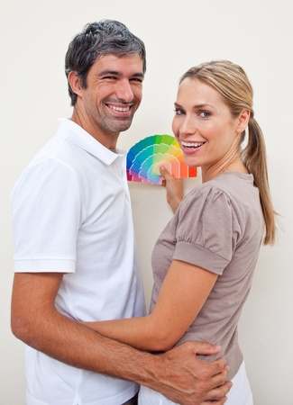 Lovers with color samples to paint their new house Stock Photo - 10241553