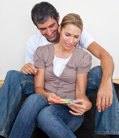 Couple choosing color to paint their new appartment photo