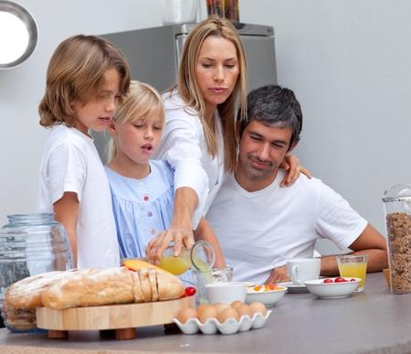 Loving family having breakfast photo