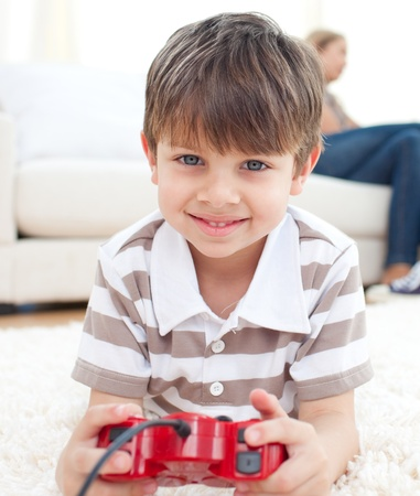 Close-up of little boy playing video games Stock Photo - 10231879