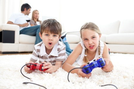 playing video games: Lively children playing video games