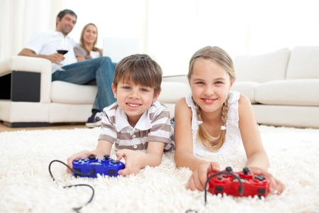 Brother and sister playing video games Stock Photo - 10259284