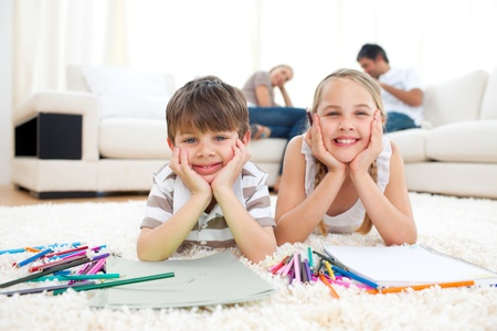 Merry siblings drawing lying on the floor Stock Photo - 10255904