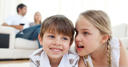 Little girl telling a secret to her brother Stock Photo - 10256797
