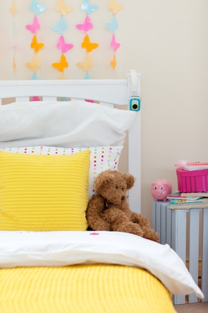master bedroom: Childs bedroom with a teddy bear on the bed Stock Photo
