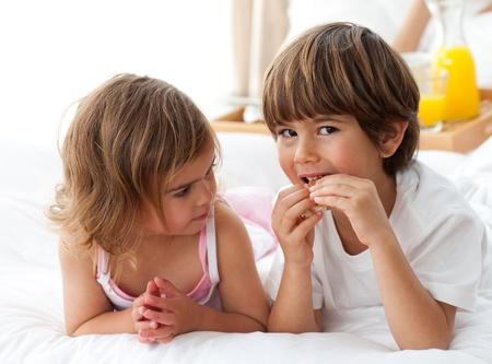 Close-up of children having breakfast