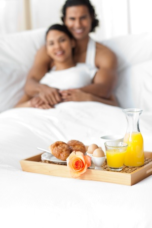 breakfasting: Couple having breakfast on the bed
