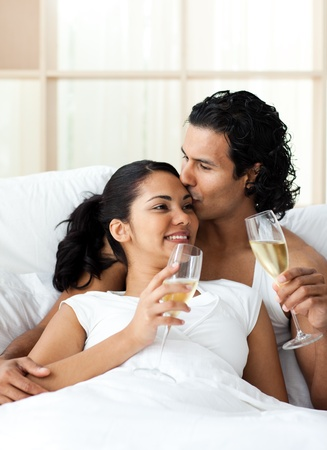 Man kissing his wife and drinking Champagne Stock Photo - 10245016