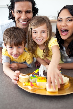 meal preparation: Lively family eating cookies