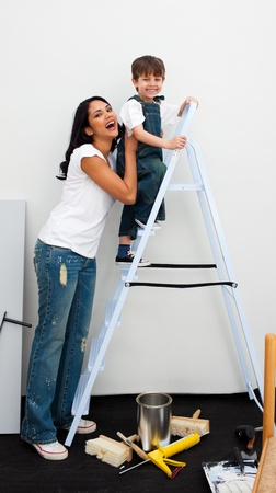 Cute little boy climbing a ladder photo