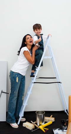 Cheerful little boy climbing a ladder  photo