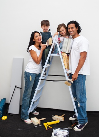 Happy young family renovating a room  photo