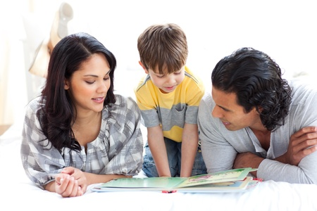 Affectionate family reading book together photo