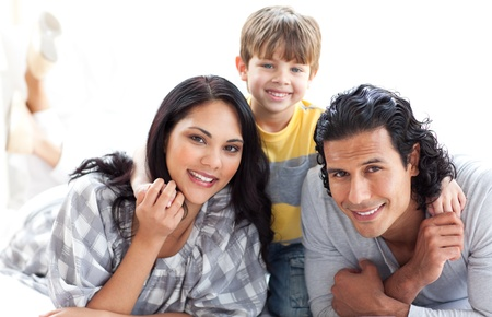 Portrait of a loving family lying on the floor Stock Photo - 10258468