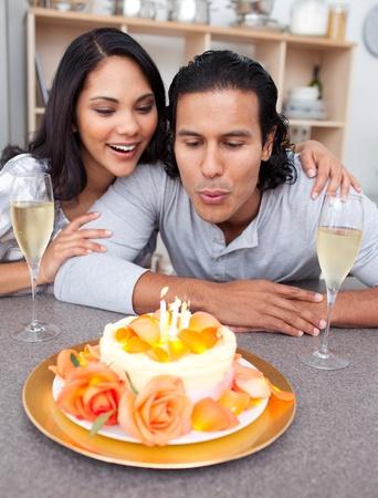 Happy man and his wife celebrating his birthday photo