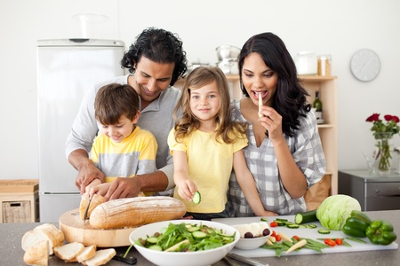Animated family preparing lunch together photo