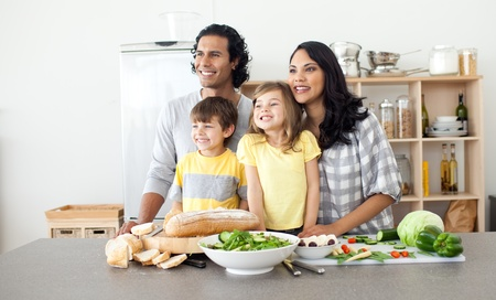 Merry family having fun in the kitchen photo