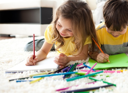 Close-up of children drawing lying on the floor  Stock Photo - 10233745