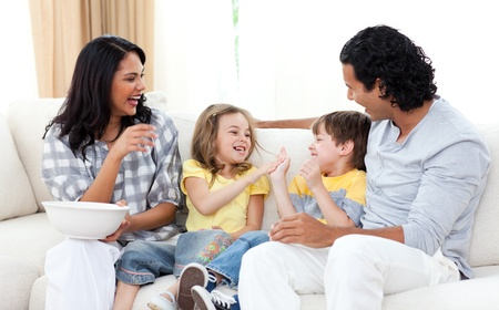 Loving family watching TV on sofa photo