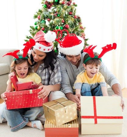 Family decorating a Christmas tree Stock Photo - 10258459