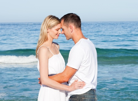 Intimate lovers embracing at the beach photo