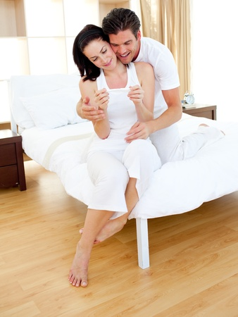finding out: Cheerful couple finding out results of a pregnancy test