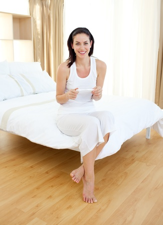 Jolly woman finding out results of a pregnancy test Stock Photo - 10256876