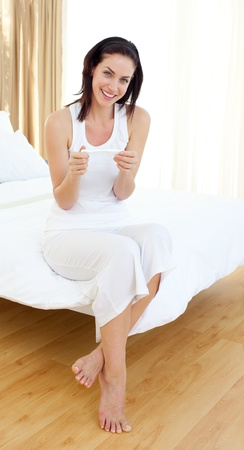 gestation: Atractive woman finding out results of a pregnancy test Stock Photo