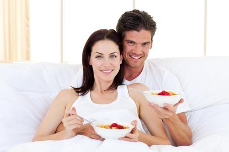Enamoured couple having breakfast photo