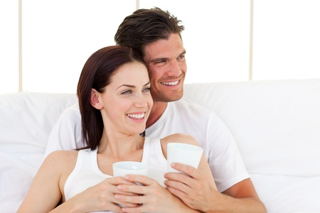 Smiling couple drinking coffee photo