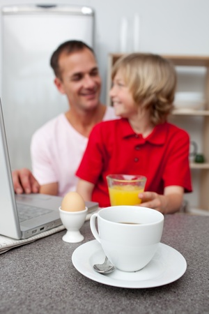 Jolly father and his son having breakfast  photo