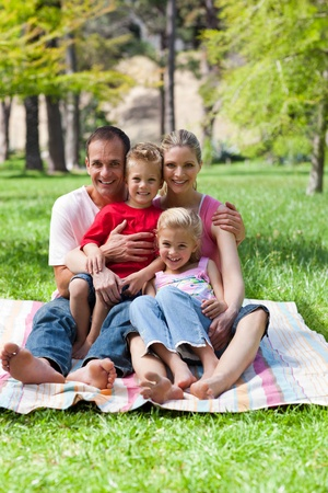 Portrait of a smiling family having a picnic photo