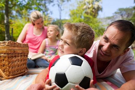 Happy family having fun at a picnic photo