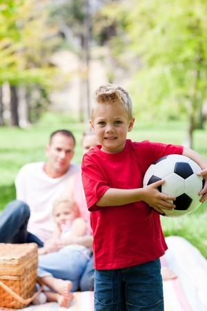 Little boy holding a soccer ball photo