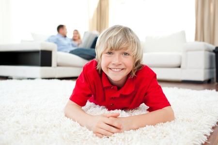 Jolly boy lying on the floor photo