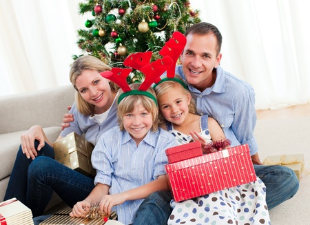 Portrait of a happy family at Christmas time photo