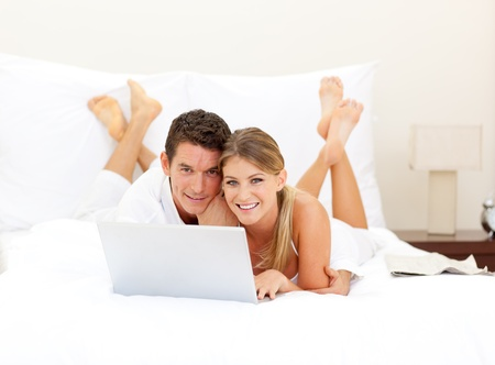 Happy couple surfing the internet  photo
