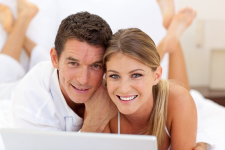 Close-up of a couple surfing the internet  photo