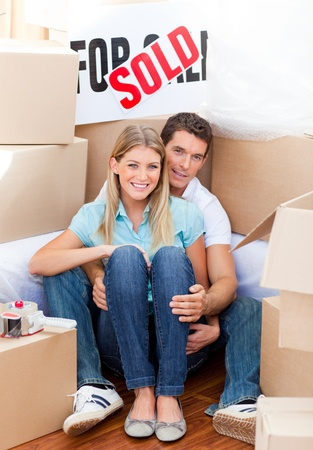 gratified: Intimate couple embracing after move in Stock Photo