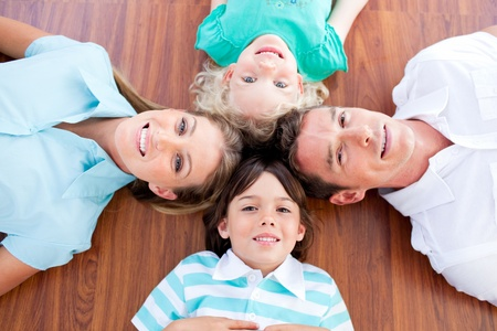 chirpy: Smiling family lying in circle on the floor
