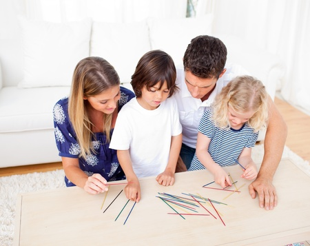 chirpy: Loving family playing mikado in the living room