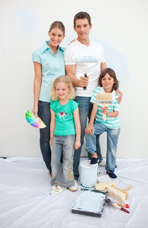 Smiling family decorating their house  photo